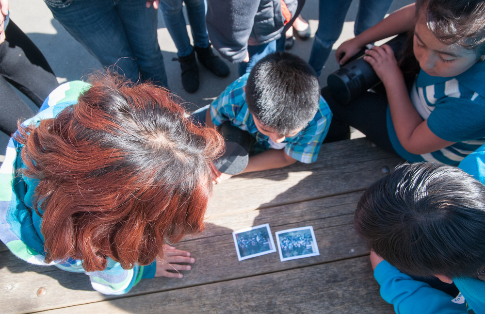 STAR // Gustavo Vasquez STUDENTS VIEWING A POLAROID OF THEMSELVES IN THE photography WORKSHOP, DURING THE 26th Annual Fuentes Academic Workshop at Sonoma State, on Saturday, March. 7, 2015.