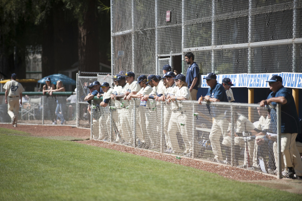 The baseball team looks on during a day game.