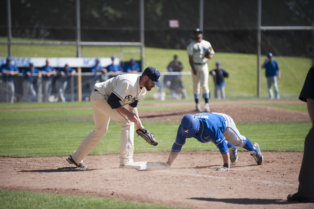 Junior catcher/first baseman Cody Morris tries tagging the runner.