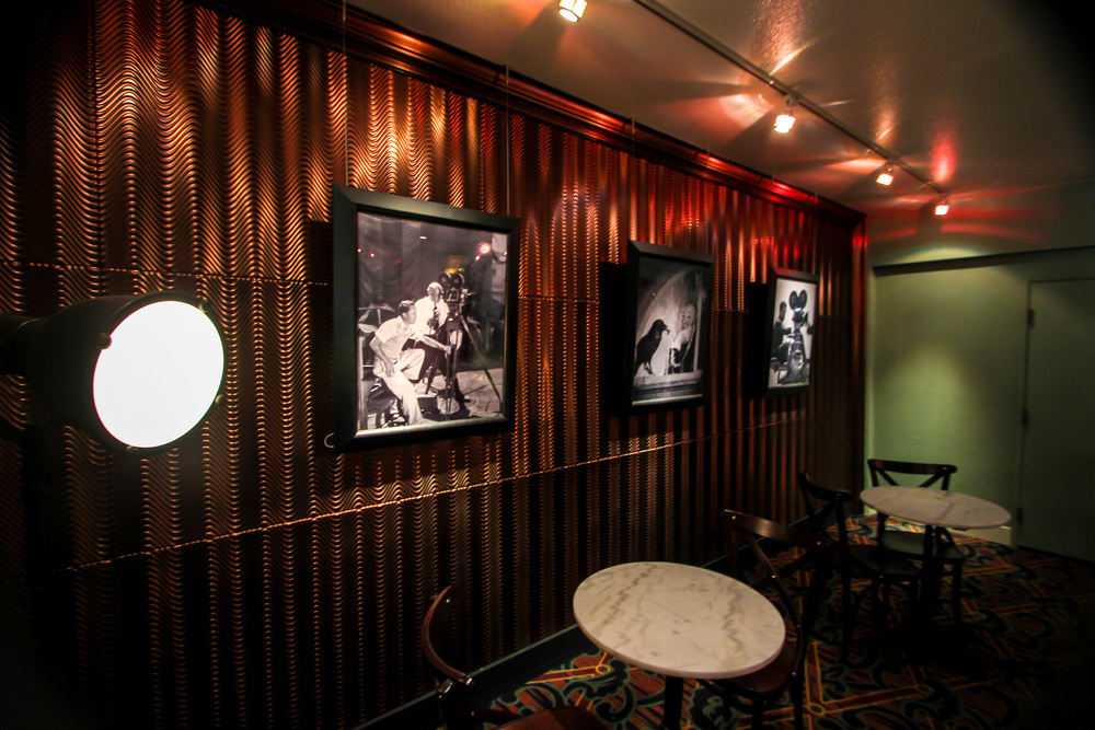 STAR // Brandon Stachnik Summerfield Cinemas features a small lounge and Hollywood memorabilia adorned on the walls of the lobby.