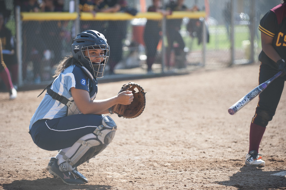 sonomaseawolves.com, STAR // Connor Gibson    Junior catcher Aubrie Tolliver looks into the Seawolves dugout earlier this year.