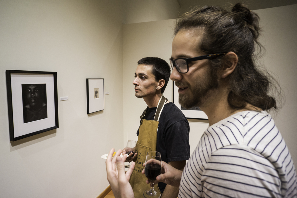 Courtesy // Gustavo Vasquez Sonoma State University students, faculty, and community membersgather in the University Art Exhibit on Thursday to view an art collection consisting of pieces of work by many photography greats.
