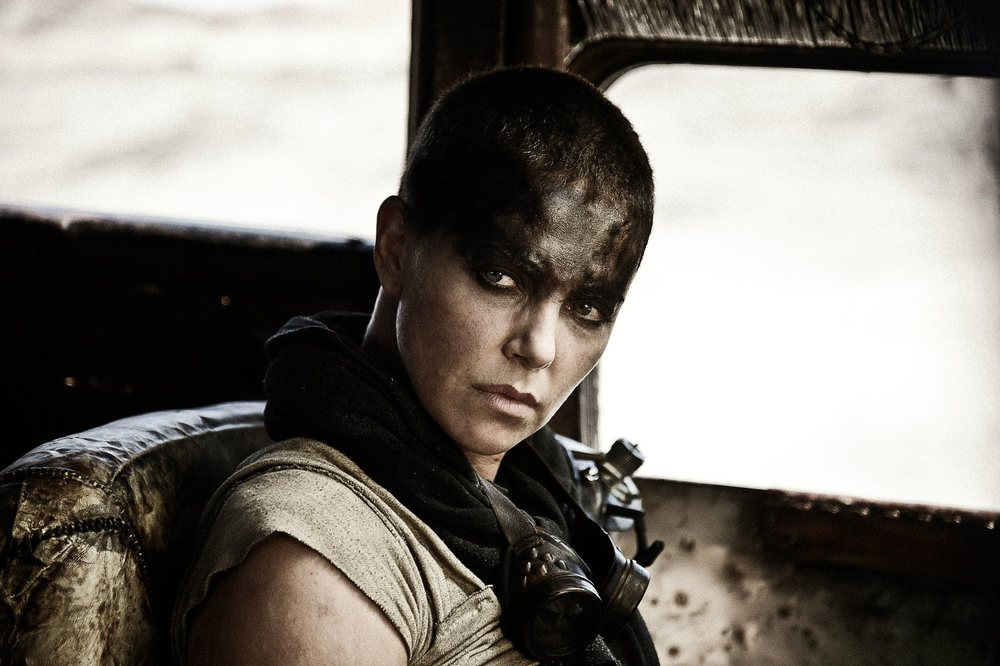 "facebook.com Charlize Theron, who plays Furiosa in the film ""Mad Max: Fury Road"" gives a rare portrayal of a strong women in the media."