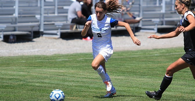 Sophmore Sara Van Wagoner advances on the Cal State L.A. defender during the team's draw.