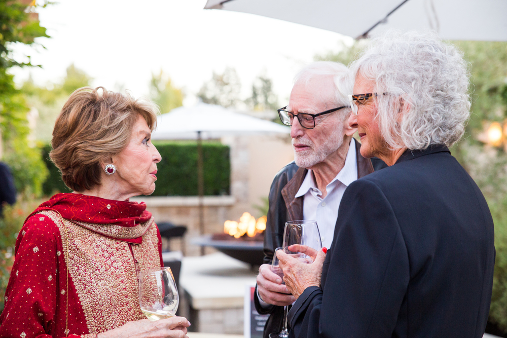 Joan Weill spoke with donors at the champagne reception.