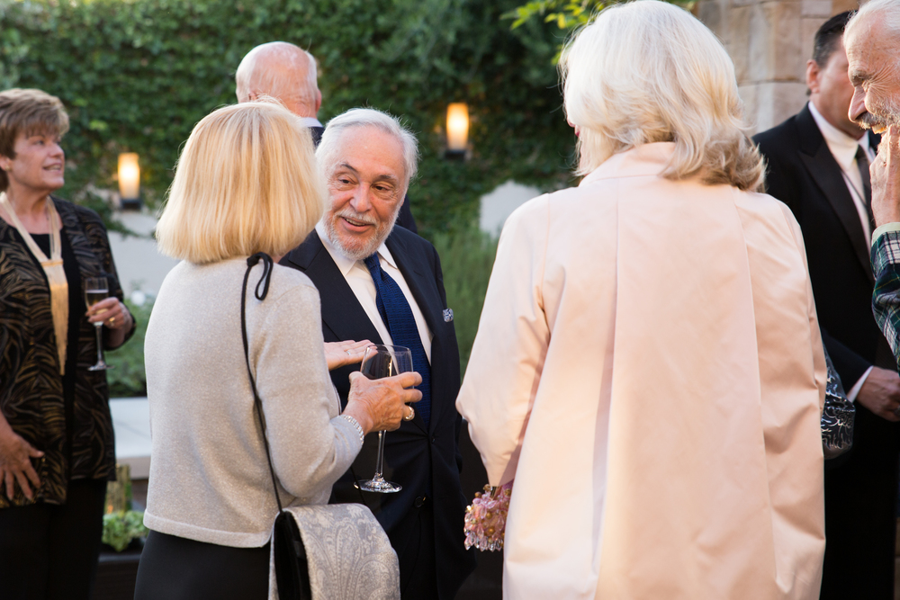 Sonoma State University President Ruben Armiñana talks with donors at the champagne reception.