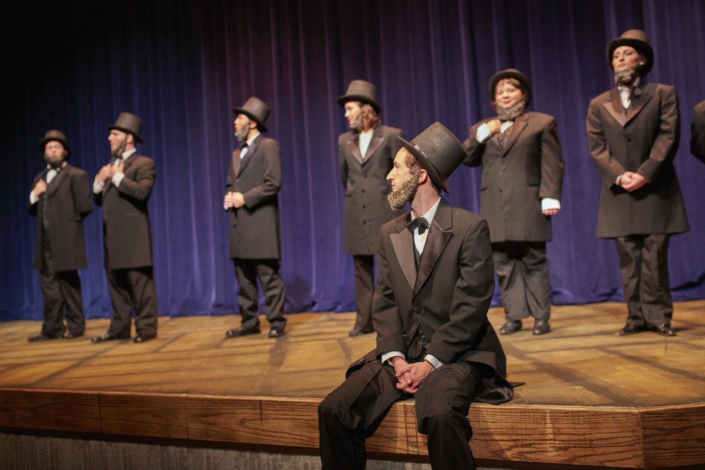 Courtesy // David Papas A lineup of Abraham Lincolns grace the stage in Person Theatre.