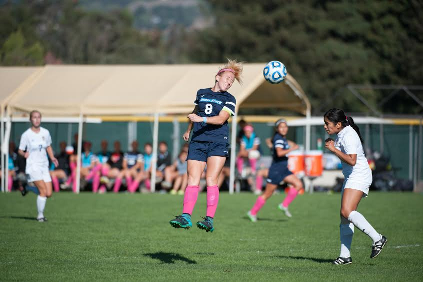 Senior Margi Osmundson successfully lands a header.