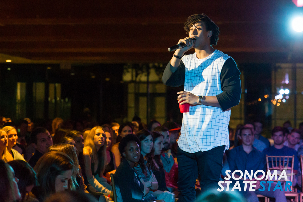 Christian Pierce greeted the audience at the SOMO Village last Friday. (Brennan Chin // Sonoma State STAR)