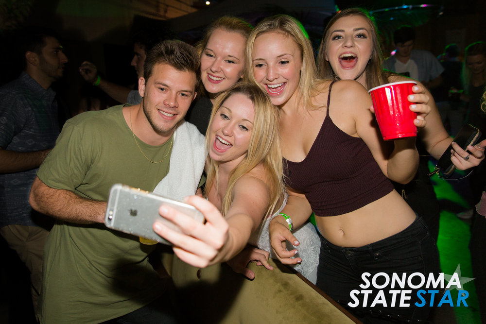 YouTube star Jimmy Tatro posed for a photo with fans at the FLI HIGH Nightclub after party last Friday. (Brennan Chin // Sonoma State STAR)
