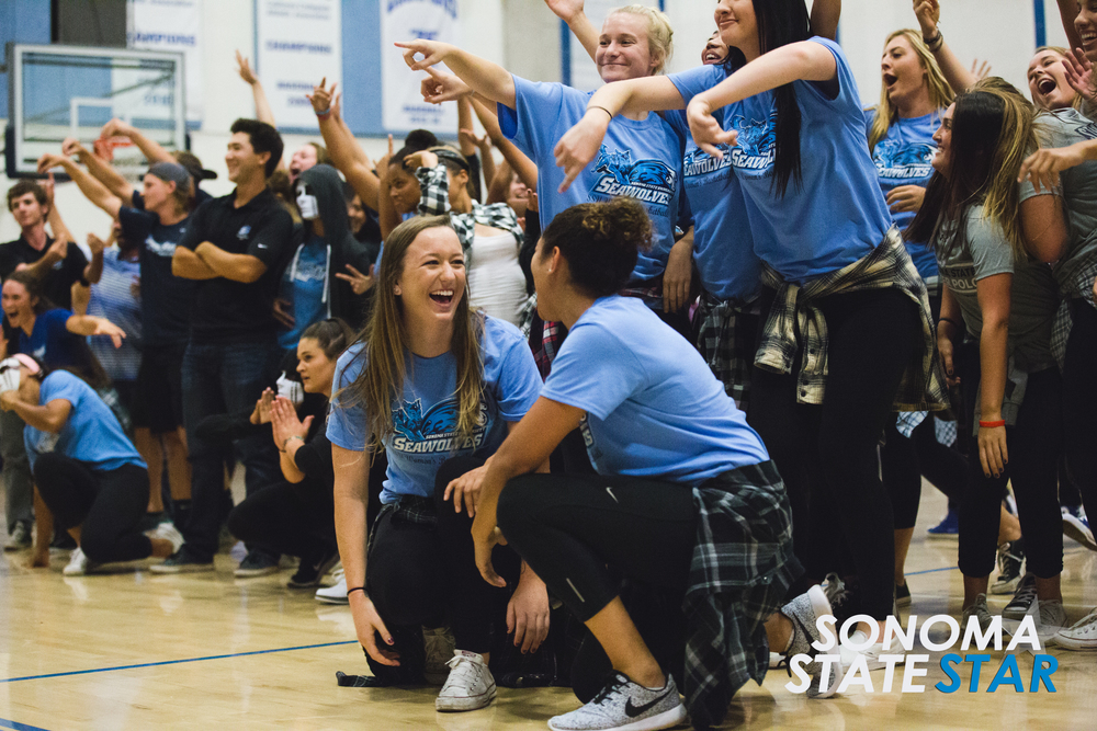 Brennan Chin // Sonoma State STAR Sonoma state athletes celebrate after completing a dance. View the full gallery here.