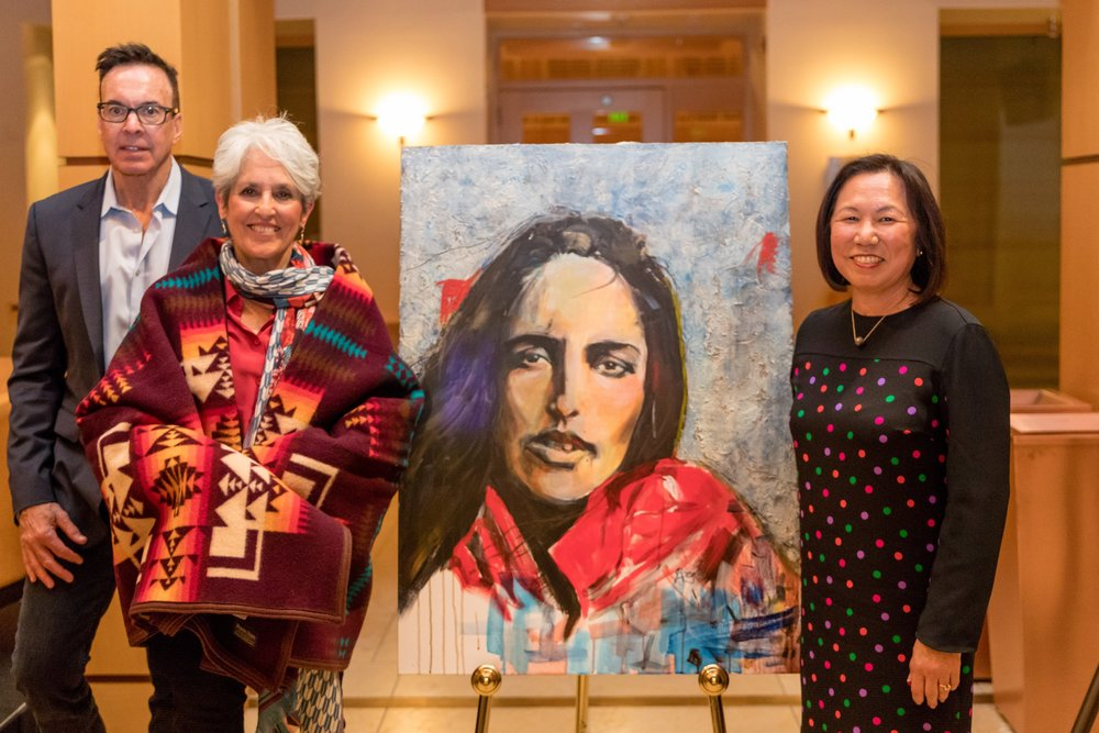 Tribal Chairman Greg Sarris, (left) Joan Baez and Judy Sakaki (right) pose in front of one of Baez's paintings as part of her 'Mischief Makers' series.