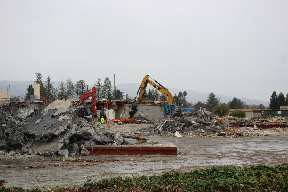 Demolition crews work to dismantle the State Farm campus on Friday, Feb. 8.