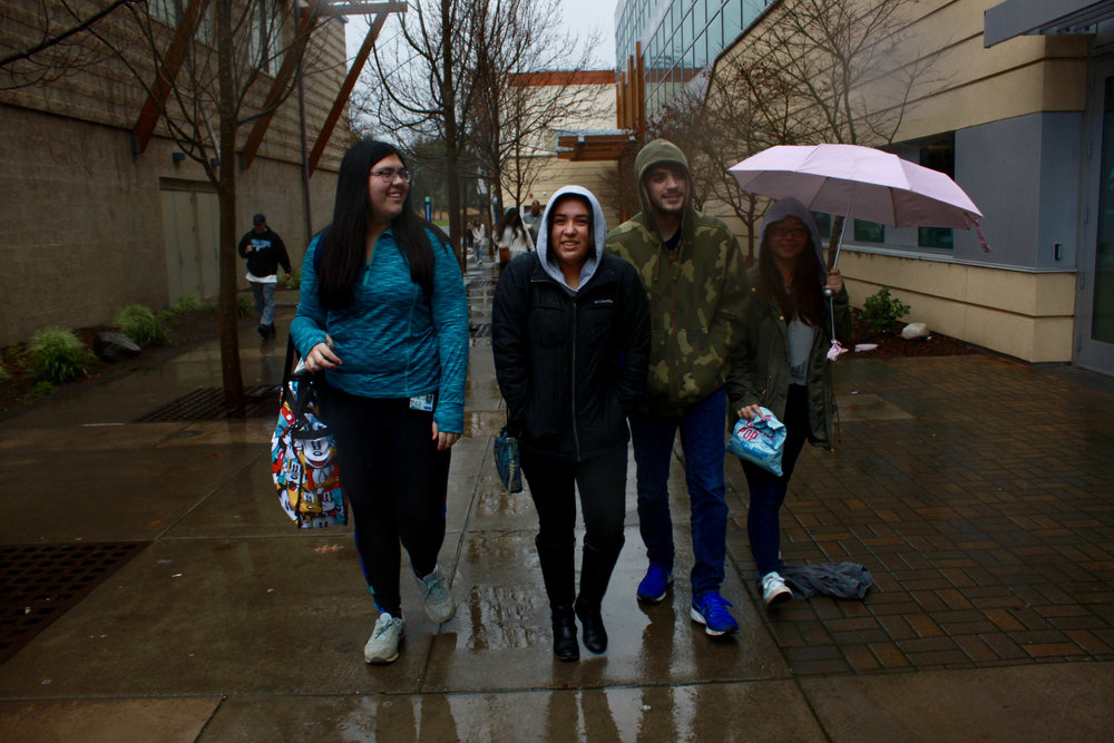 Students try to stay dry in the rainy weather on Sat. Feb. 16, 2019.