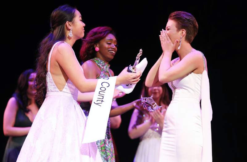 Jones, seen above, accepts her award for Miss Sonoma County, making her the first openly-gay winner of the pageant.