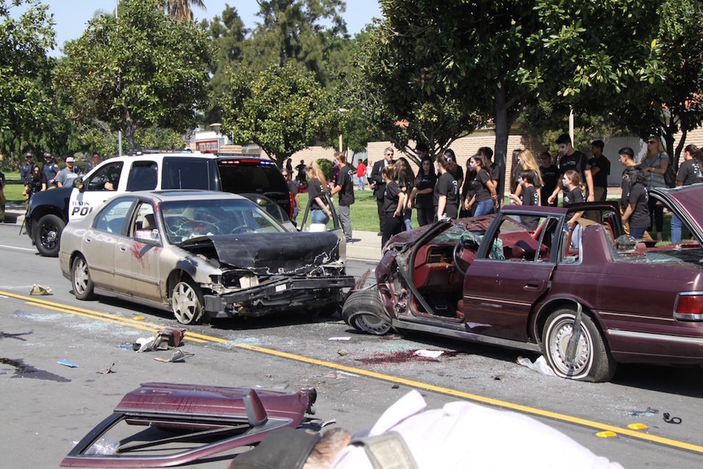 COURTESY// Behind The Badge   A staged car crash outside a high school for an Every 15 Minutes event to educate students on the dangers of driving under the influence.