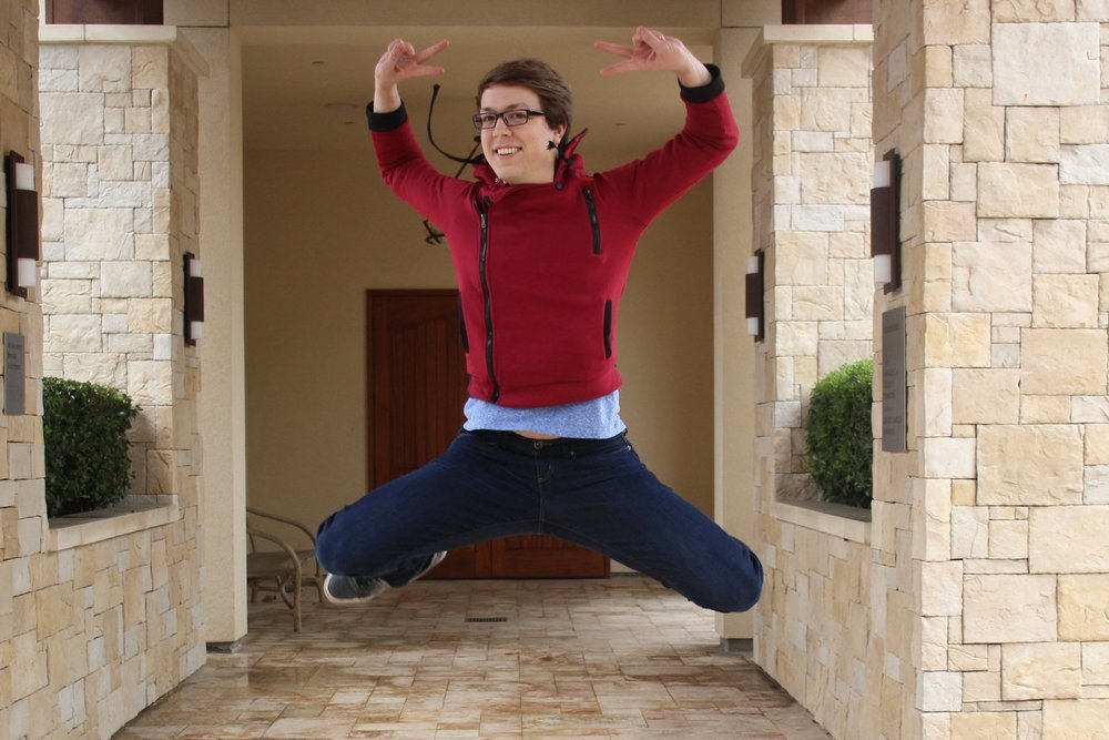 """""""Eat Your Heart Out"""" writer and Theatre Arts major Kyle Kiefer jumps for joy in preparation for the premiere of his play. (STAR // Emily Kowalski)"""