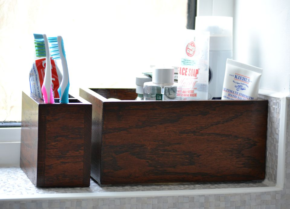 Use little boxes for bathroom storage. Photo / Angle in the North