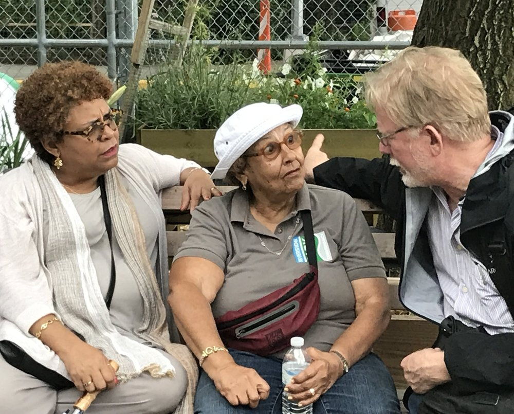 CALL CO-CHAIR CHARLES MCKINNEY DISCUSSES MULTI-GENERATIONAL URBAN GARDENING WITH PILLAR OF WEST HARLEM, JENNY BENITEZ, AND HER DAUGHTER VICTORIA.