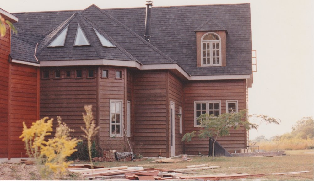 This is the back of the house, with the kitchen on the right and the big room in the middle,and an alcove off the big room. The little windows were made of shades of blue stained glass panes. Above is the north bedroom.