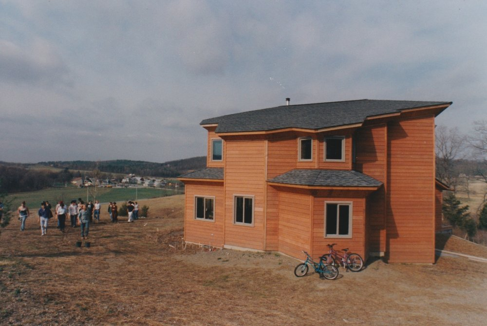 On the top floor is the back end of my workroom, and below what was the children's work room and is now our bedroom. The school had a senior class out to visit the house as it was almost finished, for part of their Architecture block.