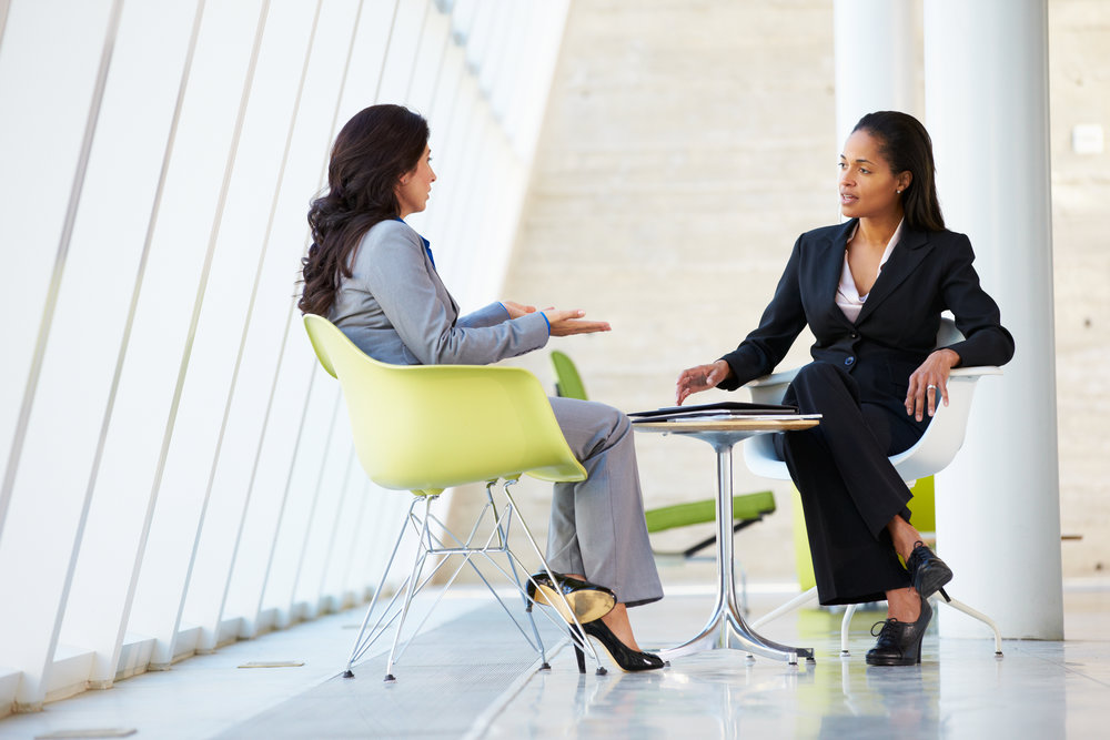 bigstock-Two-Businesswomen-Meeting-Arou-42381475.jpg