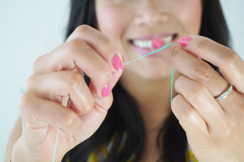 6. Move to a clean new section of floss for each inter-tooth space. (Repeating the used section of floss will spread bacterial plaque from one space to another.)