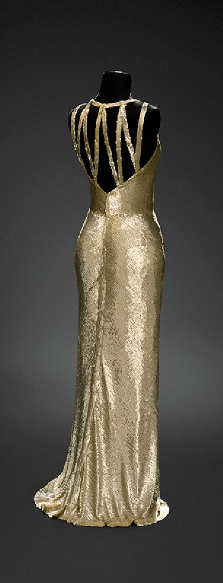This 1931 Chanel gown, which was worn by Gloria Swanson, would not be out of place at a formal event today. (photo from Musée du Costume et de la Dentelle).