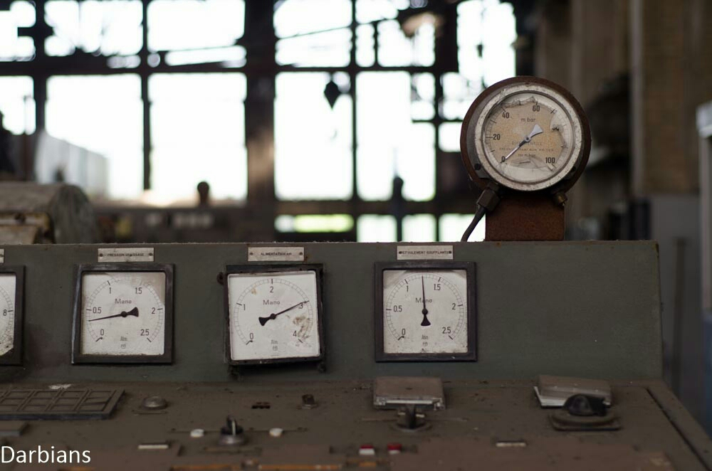 The dials in a turbine hall of an abandoned power plant in France.