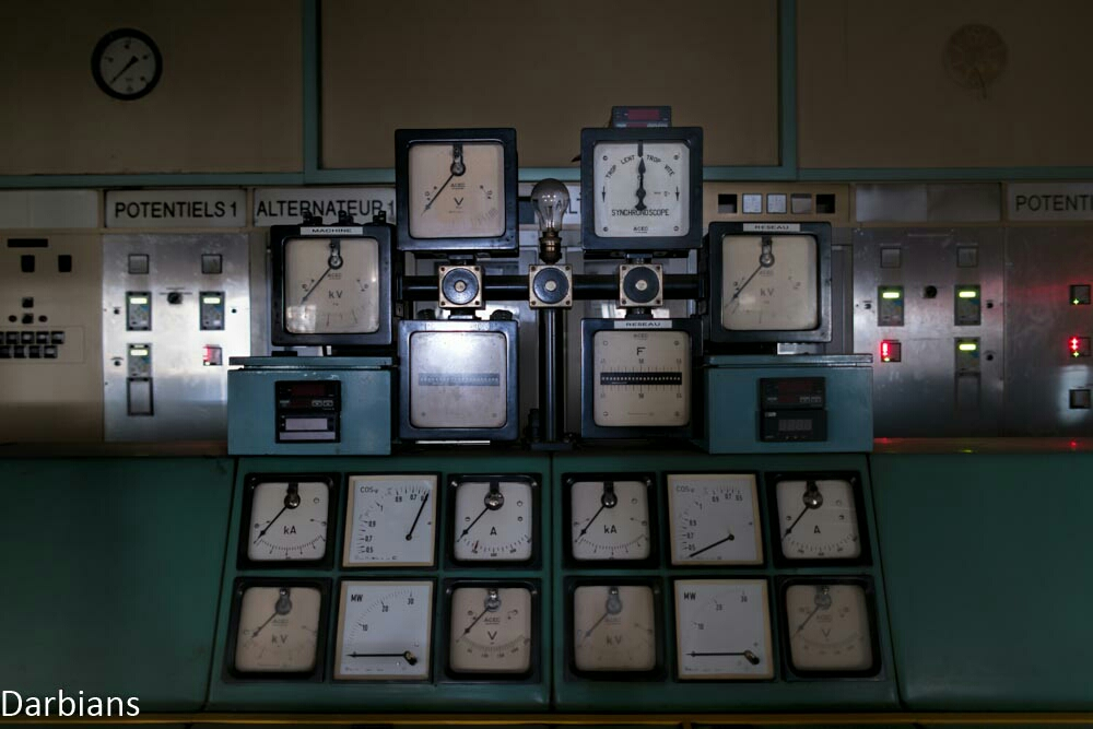 A plethora of dial in this power plants control room. Even the power was still on here!