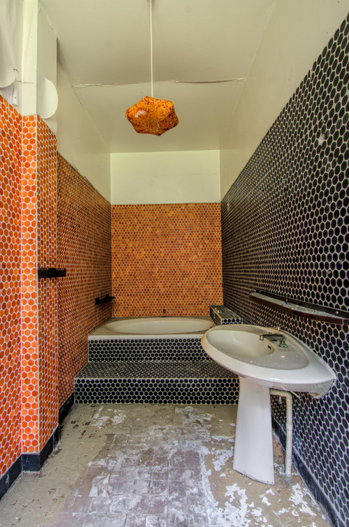 The vibrant bathroom in an abandoned hotel in France.