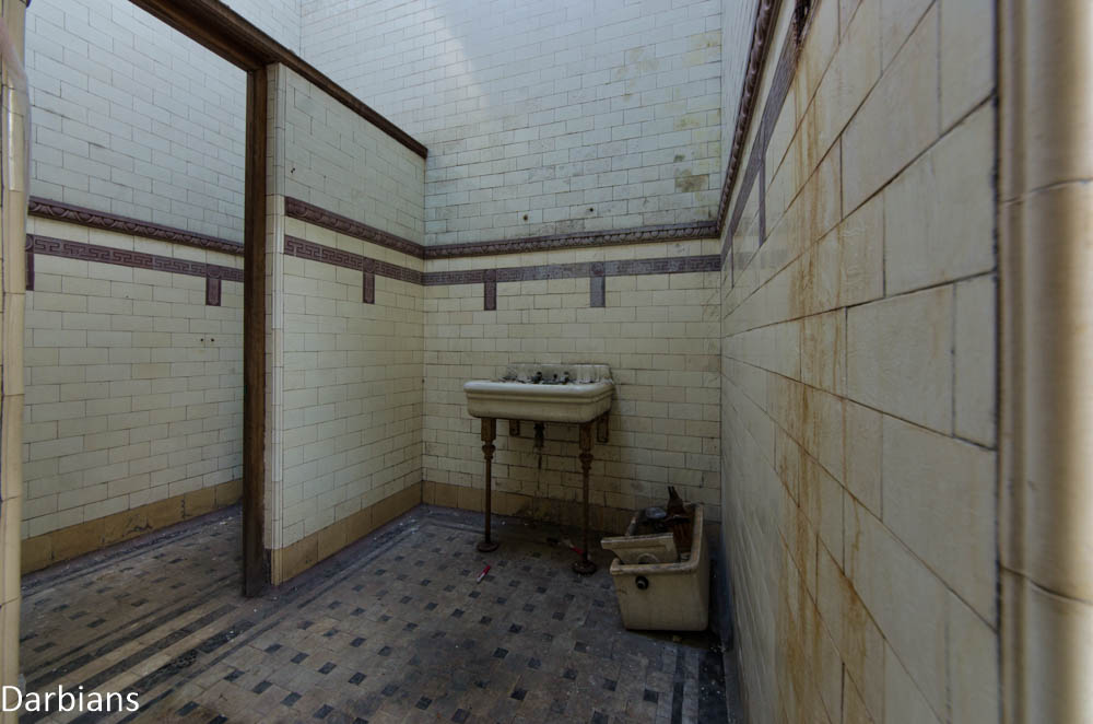 The grimey mens toilets in an abandoned spa house in England.