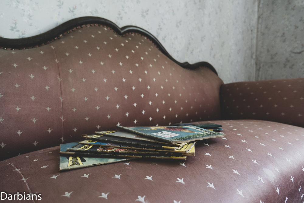 Old magazines lay on the sofa.