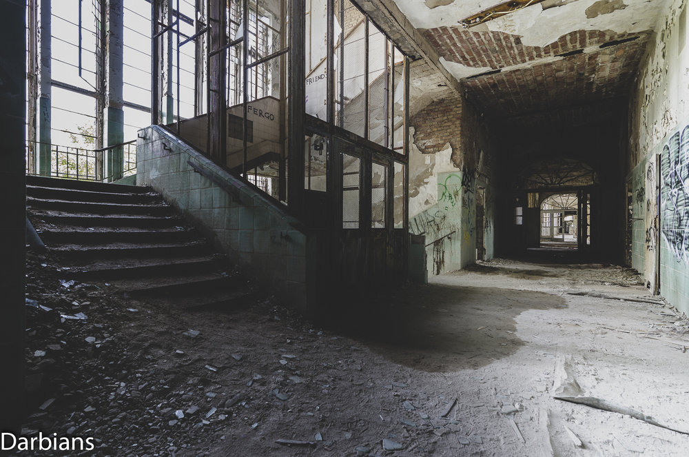 The rubble covered staircase looking down the corridor.