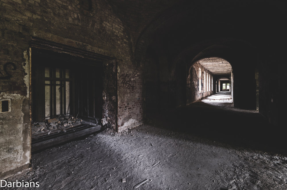 Beelitz Female Pavilions: Lift shaft looking down a corridor.