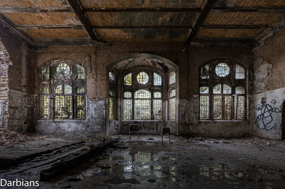 Beelitz Female Pavilions: A bed rests in front of a beautiful bay window.