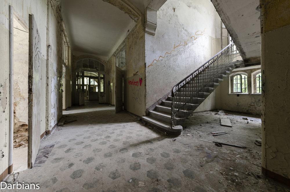 Beelitz Female Pavilions: Stairs looking down a corridor.