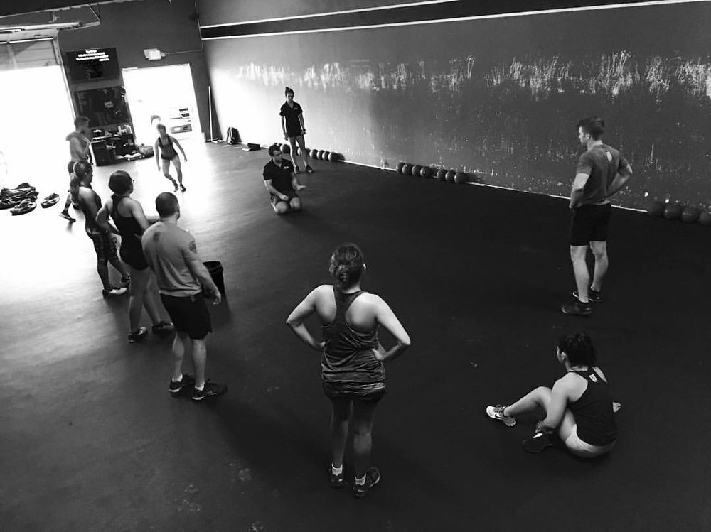 """Explaining and Demonstrating the Sand Bag Get Up. When the athlete understands the """"why"""" they are more capable of embracing what we ask them to do."""