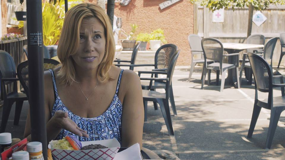 At lunch at a local eatery, Sharon complains about her under cooked burger and lack of almond milk - of course.