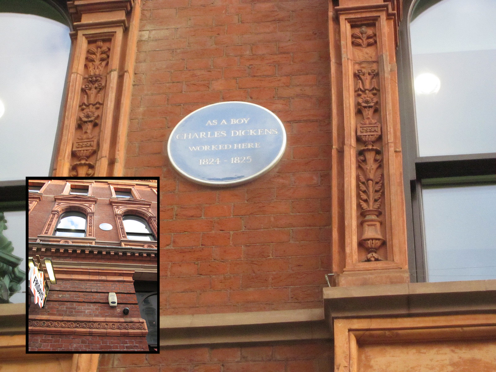 Plaque reads 'As a Boy Charles Dickens worked here 1824-1825'