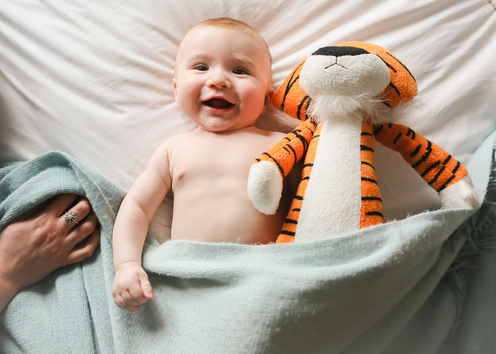 happy-baby-with-tiger