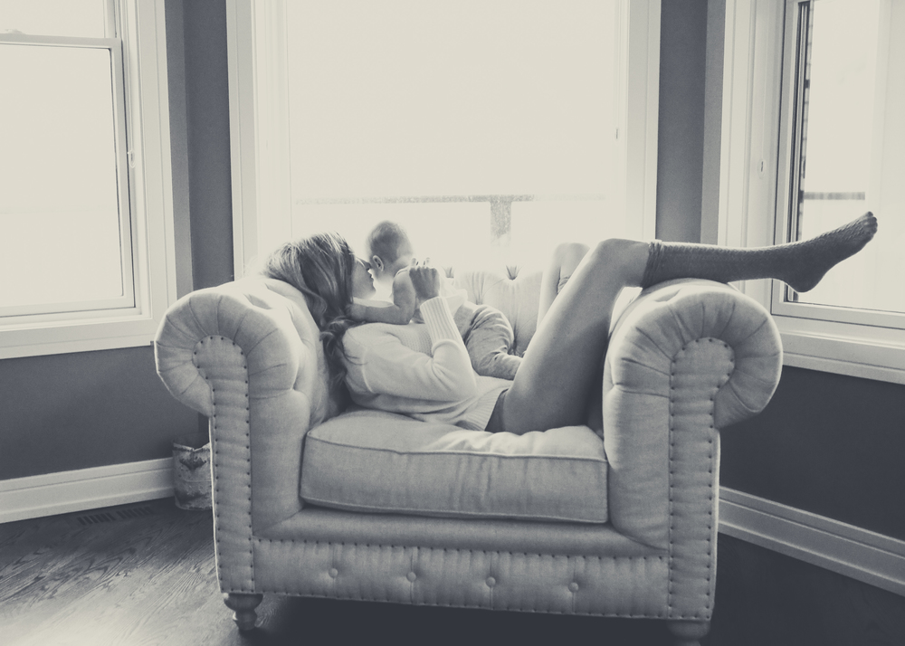 mom-on-oversized-tufted-chair
