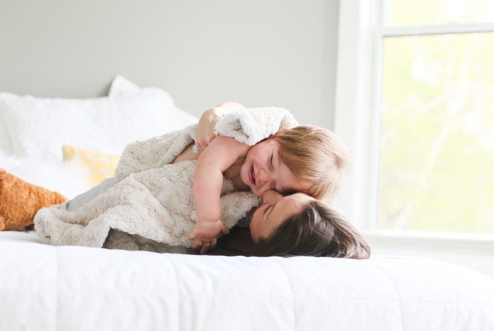 baby hugs on bed