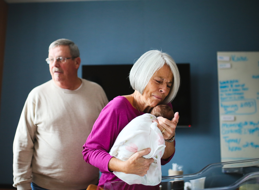grandma meeting newborn in hospital