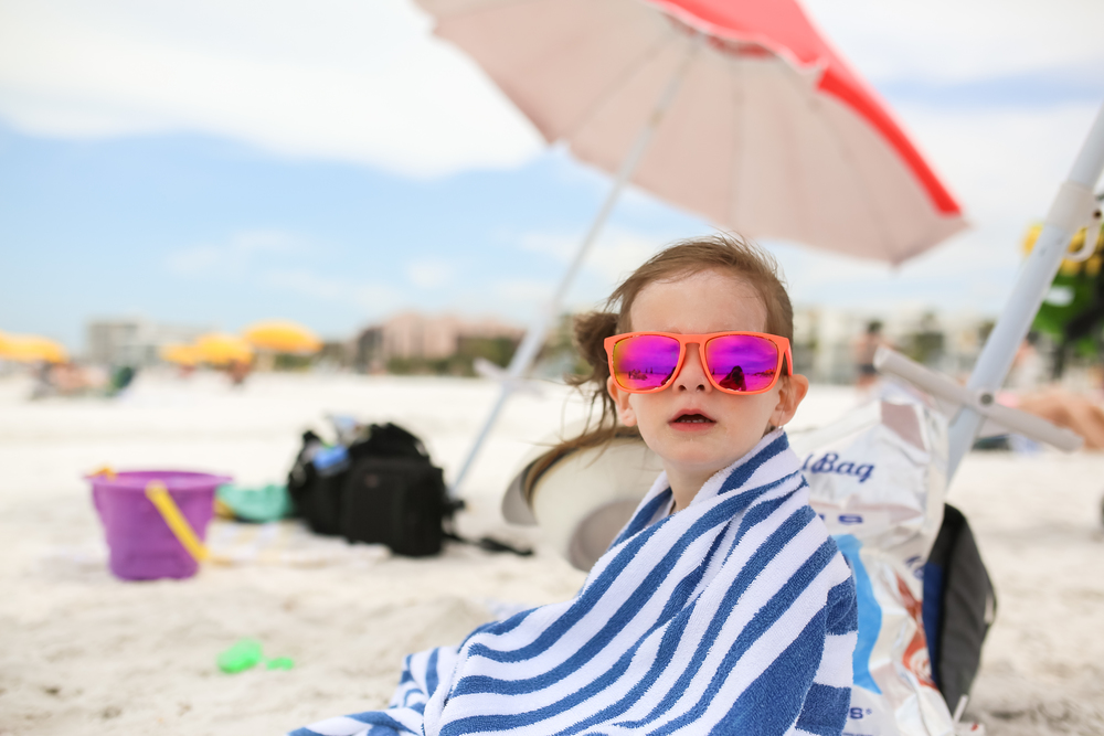 beach girl wearing sunglasses