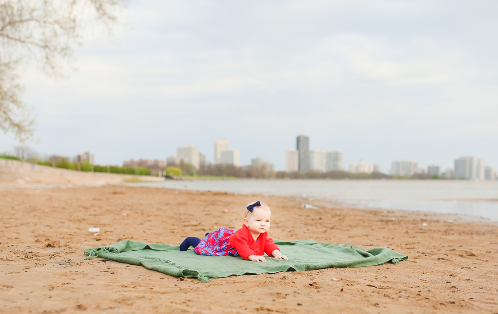 baby tummy time on the beach
