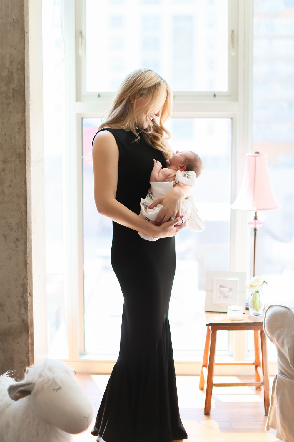 new mom in gown holding newborn