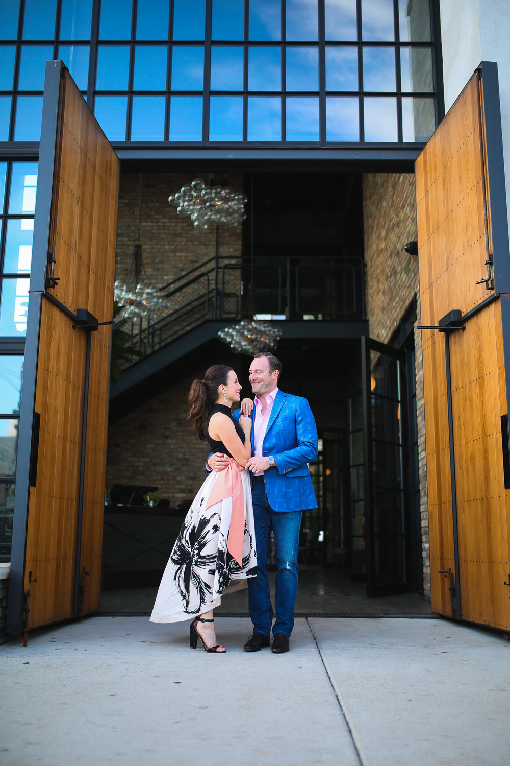 couple standing in front of chicago large doors