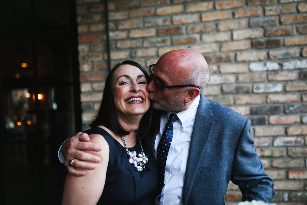 parents timeless cheek kiss