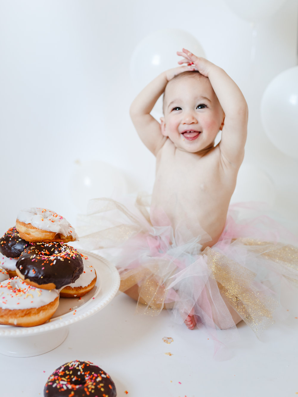 chicago studio lifestyle baby photographer birthday girl donuts jenny grimm photography
